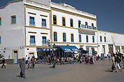 People sitting at outdoor cafe tables, Place Moulay Hassan, Essaouira, Morocco