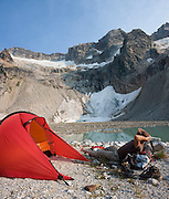 Jim Prager relaxes at camp by Luna Lake, Northern Picket Range, North Cascades National Park, Washington.