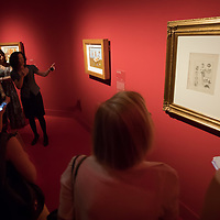 Visitors listen to a guided tour of the Frida Kahlo exhibition at the National Gallery in Budapest, Hungary on July 5, 2018. ATTILA VOLGYI