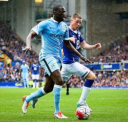 Yaya Toure of Manchester City attacks against Everton's James McCarthy  - Mandatory byline: Matt McNulty/JMP - 07966386802 - 23/08/2015 - FOOTBALL - Goodison Park -Everton,England - Everton v Manchester City - Barclays Premier League