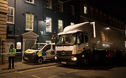 © Licensed to London News Pictures. 06/03/2018. Salisbury, UK. Police use a Tesco delivery truck to block the front ebtrance of the Zizzi restaurant as they search inside in protective suits and gas masks after former Russian spy Sergei Skripal and his daughter were taken ill with suspected poisoning. The couple where found unconscious on bench in Salisbury shopping centre. Specialist units have been called in to deal with any possible contamination. Photo credit: Peter Macdiarmid/LNP
