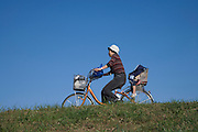 mother with child cycling Japan