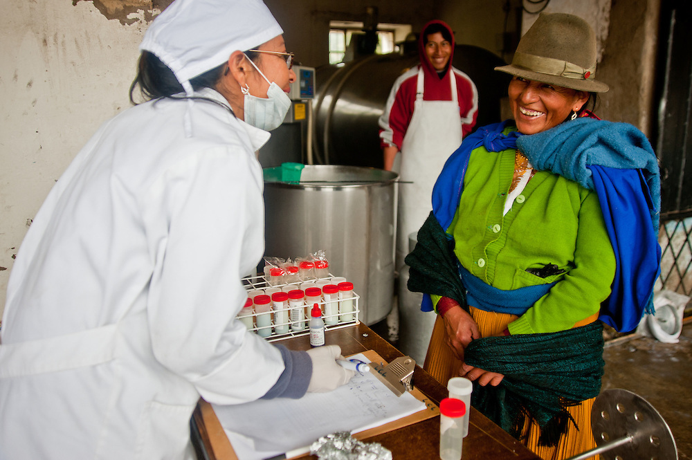 A young woman proudly delivers milk from her two cows to the quality testing facility in the Andes of Ecuador.