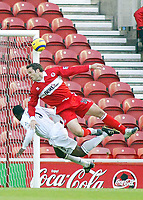 7/11/2004 - FA Barclayship Premiership - Middlesbrough v Bolton Wanderers - The Riverside Stadium<br />Middlesbrough's Mark Viduka and Bolton Wanderers' Rahdi jaidi both try to head the ball.<br />Photo:Jed Leicester/Back Page Images