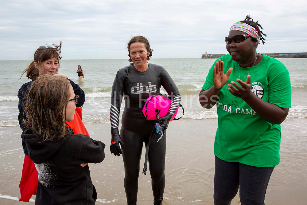 Award winning actress and Folkestone resident Jessica Hynes completed a 4 mile sea swim on the with 12 laps of Folkestone sunny sands bay to raise money for charity on the 7th of July 2020 in Folkestone, United Kingdom. She swam for two different charities, one being the Folkestone community hub, which has been supporting vulnerable people during the Covid-19 lockdown and the second called Green Kordofan which supports children in a refugee camp in Yida, South Sudan. Mrs Hynes is one of many volunteers who have worked at the hub, which provides help by delivering groceries, collecting prescriptions or just being a voice on the end of the phone.The second charity is Green Kordofan, which supports children in a refugee camp in Yida, South Sudan and was founded by Raga Gibreel, also from Folkestone.The registered charity is currently raising money for essential hygiene facilities such as washing and toilet blocks, to make the camp safe for the children who have been displaced by war.