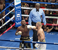 August 26, 2017 - Las Vegas, NEVADA, USA - Floyd Mayweather Jr., (Black and Gold shorts), fights Conor McGregor (White Shorts)in a super welterweight boxing match Saturday, Aug. 26, 2017, in Las Vegas. (Credit Image: © Armando Arorizo/Prensa Internacional via ZUMA Wire)