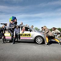Nederland, Hilversum , 3 oktober 2013.<br /> Presentatoren en journalisten van de rubriek de Belbus door de jaren heen.<br /> de Belbus is een rubriek van Kassa van de VARA.<br /> In het midden achter op de auto, de bedenker presentator Felix Meurders.<br /> Foto:Jean-Pierre Jans