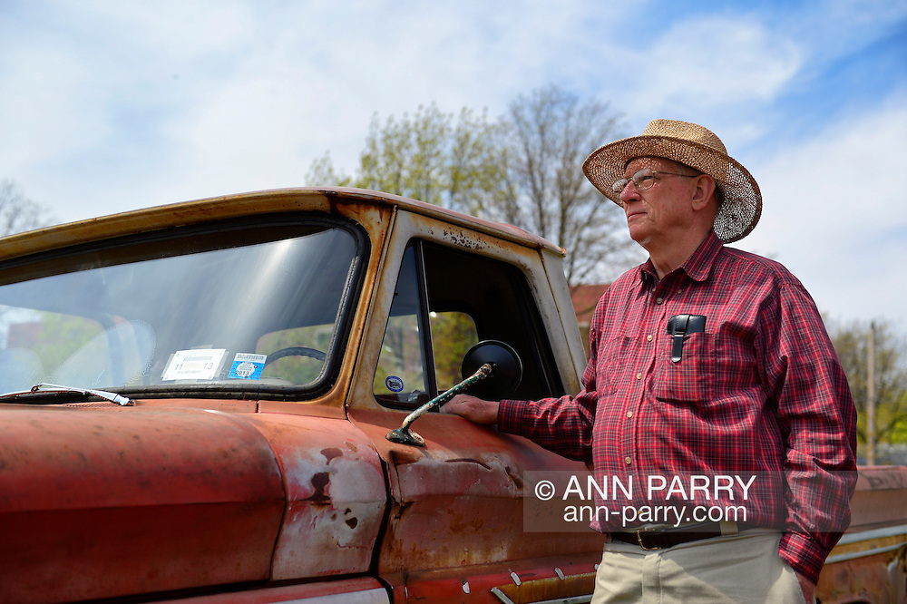 April 28, 2013 - Floral Park, New York, U.S. - PAUL GRAMLICH is standing next his red and white 1964 Chevrolet C-10 pickup at the Antique Auto Show, where New York Antique Auto Club members exhibited their cars on the farmhouse grounds of Queens County Farm Museum. Gramlich explained that the truck, now rusted, which he and his wife Janet own, has been in the Gramlich family since it was new.