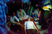 Syrian civilians are participating in a burial ceremony of a young man who had allegedly been shot by a Syrian government sniper during his journey in Aleppo on Sunday, June 10, 2012. (Photo by Vudi Xhymshiti)