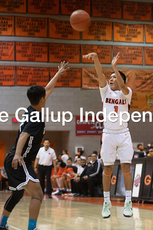 Gallup Bengal Quentin Richards (1) takes a jump shot against the Chaparral Lobos at Gallup High School Saturday night in the first round of the New Mexico Activities Association 2020 State Basketball Championships in Gallup. With their 90-56 win over the Lobos Gallup advances to the quarterfinal round and will play Espanola Valley Wednesday evening in Albuquerque.