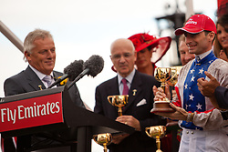 2010 Melbourne cup winning Jockey Gerald Mosse being awarded the  Melbourne cup.