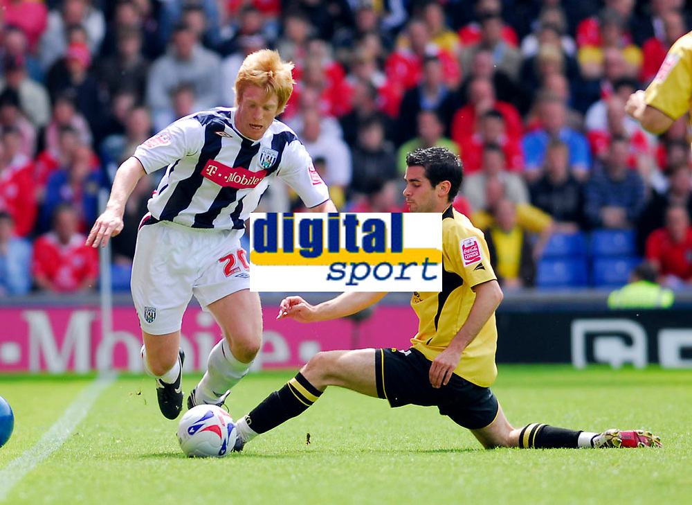 Photo: Leigh Quinnell.<br /> West Bromwich Albion v Barnsley. Coca Cola Championship. 06/05/2007. West Broms Paul McShane comes under attack from Barnsleys Daniel Nardiello.