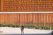 A woman walks past an artwork in the Santa Lucia Riverwalk at the Museum of the Northeast or Museo del Noreste adjacent to the Macroplaza Grand Plaza in the Barrio Antiguo neighborhood of Monterrey, Nuevo Leon, Mexico.