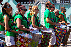 Samba drummers make their way along Ladbroke Grove as day one, Children's Day, of the Notting Hill Carnival gets underway in London. London, August 25 2019.