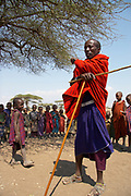Maasai teacher instructing children in rural tribal village near the Olduvai Gorge