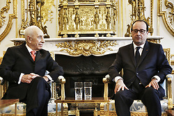 French President Francois Hollande receives former Israeli President, Nobel Peace Prize laureate and President of the Peres Center for Peace, Shimon Peres, at the Elysee Palace in Paris, France on December 18, 2014. Photo Pool by Denis Allard/ABACAPRESS.COM