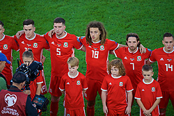CARDIFF, WALES - Friday, September 6, 2019: Wales players line-up before the UEFA Euro 2020 Qualifying Group E match between Wales and Azerbaijan at the Cardiff City Stadium. L-R: Tom Lawrence, Chris Mepham, Ethan Ampadu, Joe Allen. (Pic by Paul Greenwood/Propaganda)