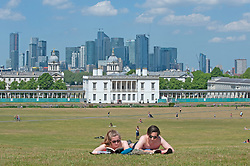 ©Licensed to London News Pictures 21/05/2020<br /> Greenwich, UK. A couple reading books while sunbathing in front of the Queen's house. People out and about in Greenwich park, Greenwich, London this afternoon enjoying lockdown freedom as the mini heatwave hot weather continues with temperatures set to hit 28C in parts of the UK.  Photo credit: Grant Falvey/LNP