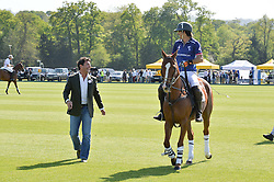 Left to right, GIORGIO VERONI and polo player  NACHO FIGUERAS at the St.Regis International Polo Cup at Cowdray Park, Midhurst, West Sussex on 16th May 2015.