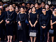 26 OCTOBER 2017 - BANGKOK, THAILAND:People in line to leave sandalwood flower offerings for the late king during the funeral ceremony for Bhumibol Adulyadej, the Late King of Thailand. The king died on 13 October 2016 and was cremated 26 October 2017, after a mourning period of just over one year. The revered monarch was the longest reigning king in Thai history and is credited with guiding Thailand through the turbulent latter half of the 20th century.   PHOTO BY JACK KURTZ