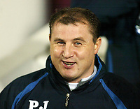 Photo: Chris Ratcliffe.<br />West Ham United v Wigan Athletic. The Barclays Premiership. 28/12/2005.<br />Paul Jewell is a happy man at Wigan's first half performance.