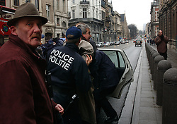 BRUSSELS, BELGIUM - JAN-30-2005 -  Police arrest a man who caused a disturbance outside the Grand Synagogue in Brussels before the start of a memorial service in remembrance of the liberation of the notorious Nazi concentration camp at Auschwitz. (Photo © Jock Fistick)