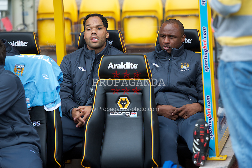 WOLVERHAMPTON, ENGLAND - Saturday, October 30, 2010: Manchester City's Joleon Lescott and Patrick Vieira on the bench before the Premiership match against Wolverhampton Wanderers at Molineux. (Pic by: David Rawcliffe/Propaganda)