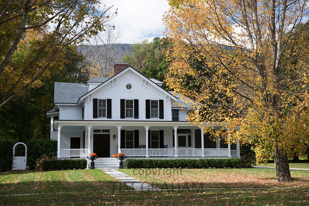 Typical stylish and elegant white clapboard New England dwelling house with traditional stoop in Manchester, Vermont, USA