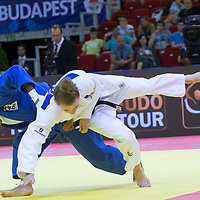 Rafaela Silva (in blue) of Brazil and Theresa Stoll (in white) of Germany fight during the Women -57 kg category at the Judo Grand Prix Budapest 2018 international judo tournament held in Budapest, Hungary on Aug. 10, 2018. ATTILA VOLGYI