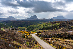 Mountains (l to r) Canisp, Suilven and Cul Mor in Inverpolly and  the North Coast 500 scenic driving route in northern Scotland, UK
