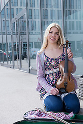 Caucasian teenage girl musician playing violin, Munich, Bavaria, Germany
