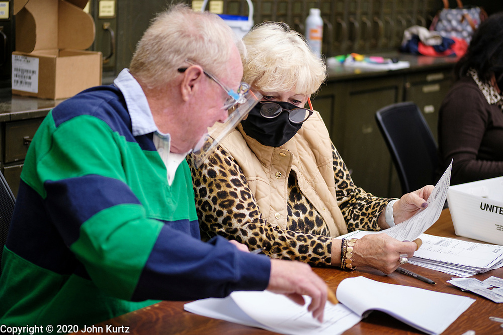 09 NOVEMBER 2020 - NEWTON, IOWA: Members of the 10 person audit board recount ballots by hand in Jasper County. The Jasper County (Iowa) auditor ordered a manual recount of 561 votes from Clear Creek Poweshiek precinct in Mingo after vote totals were incorrectly transcribed on a spreadsheet. The incorrect vote total tabulation could affect the outcome of the election for Iowa's second congressional district. The incorrect transcription awarded more votes to Republican Congressional candidate Mariannette Miller-Meeks than she actually won and changed the outcome of the race. The corrected totals changed 162 votes and put Rita Hart, the Democratic candidate in the lead by 282 votes. The race is one of the closest races for a Congressional seat.     PHOTO BY JACK KURTZ