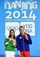 Stup<br /> 27.08.2014<br /> Foto: imago/Digitalsport<br /> NORWAY ONLY<br /> <br /> NANJING, Aug. 27, 2014 -- Alejandra Orozco Loza (L) of Mexico and Daniel Jensen of Norway celebrate during the awarding ceremony of the Mixed International Team Final of Diving at the Nanjing 2014 Youth Olympic Games in Nanjing, capital of east China s Jiangsu Province, on August 27, 2014. Alejandra Orozco Loza and Daniel Jensen won the gold medal.
