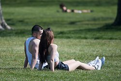 © Licensed to London News Pictures. 10/04/2020. London, UK. People sun bathing on Primrose Hill in London, during a pandemic outbreak of the Coronavirus COVID-19 disease. The public have been told they can only leave their homes when absolutely essential, in an attempt to fight the spread of coronavirus COVID-19 disease. Photo credit: Ben Cawthra/LNP