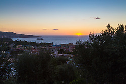 Sorrento, Italy, September 17 2017. The sun sets across the Bay of Naples, seen from the town of Meta near Sorrento, southern Italy. © Paul Davey
