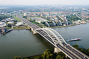 Nederland, Zuid-Holland, Gemeente Rotterdam, 28-09-2014; Van Brienenoordbrug met autosnelweg A16 over de Nieuwe Maas. Rivium en Kralingse Veer (deelgemeente Prins Alexander) in de achtergrond<br /> River Meuse with the double bridge (Van Brienenoord) of the motorway A16, skyline Rotterdam<br /> luchtfoto (toeslag op standard tarieven);<br /> aerial photo (additional fee required);<br /> copyright foto/photo Siebe Swart