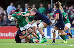 Ireland's Ciara Griffin is tackled by France's Caroline Drouin and Romane Menager during the 2017 Women's Rugby World Cup, Pool C match at UCD Bowl, Dublin.