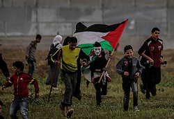 March 30, 2019 - Gaza City, The Gaza Strip, Palestine - Thousands of Palestinians gathered  east of Gaza city in a mass demonstration to mark the one-year anniversary of the  'Great march of Return', 2 Palestinian were killed 30 people injured after Israeli troops use live fire to break up the protest. (Credit Image: © Abed Alrahman Alkahlout/Quds Net News via ZUMA Wire)