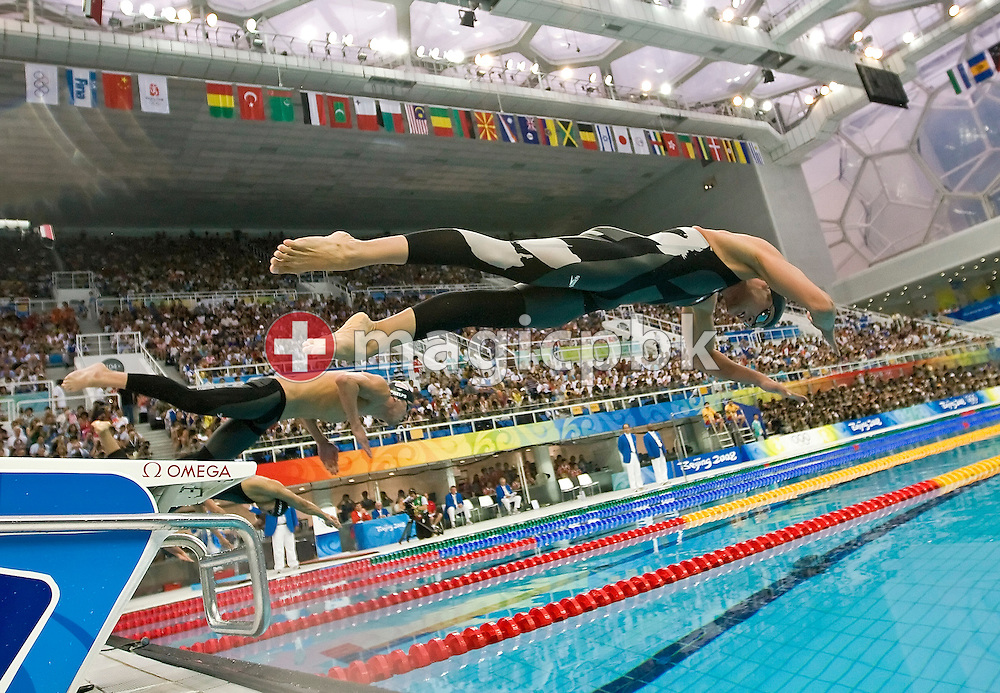Dominik MEICHTRY (front) of Switzerland and Michael Phelps (behind) of the USA start in the men's 200m freestyle semifinal 2 at the National Aquatics Center at the Beijing 2008 Olympic Games in Beijing, China, Saturday, Sept. 13, 2008. (Photo by Patrick B. Kraemer / MAGICPBK)