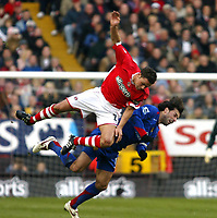 Photo: Chris Ratcliffe.<br />Charlton Athletic v Manchester United. The Barclays Premiership. 19/11/2005.<br />Ruud van Nistlerooy (R) takes a fall after missing a header.