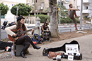 Israel, Tel Aviv, Rothschild Boulevard. A street musician and juggler April 2009
