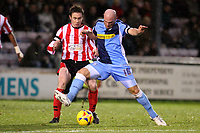 Photo: Pete Lorence.<br />Lincoln City v Wycombe Wanderers. Coca Cola League 2. 30/12/2006.<br />Tommy Mooney tackling Mark Stallard.