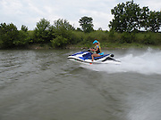 Kay Pratt riding Honda Personal Watercraft PWC along the McClellen-Kerr Arkansas River Navigation System in Oklahoma.