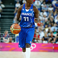 09 August 2012: France Emilie Gomis brings the ball upcourt during the 81-64 Team France victory over Team Russia, during the women's basketball semi-finals, at the 02 Arena, in London, Great Britain.