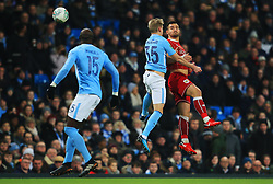 Bailey Wright of Bristol City wins a header above Oleksandr Zinchenko of Manchester City - Mandatory by-line: Matt McNulty/JMP - 09/01/2018 - FOOTBALL - Etihad Stadium - Manchester, England - Manchester City v Bristol City - Carabao Cup Semi-Final First Leg