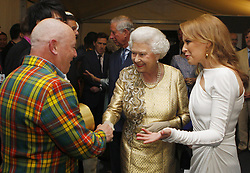 Embargoed to 0001 Monday May 28 File photo dated 4/6/2012 of Queen Elizabeth II meets Madness and Kylie Minogue backstage at The Diamond Jubilee Concert outside Buckingham Palace, London. The pop star and actress turns 50 on Monday.