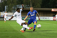 Swansea City striker Marvin Emnes (11) and AFC Wimbledon midfielder Dean Parrett (18) during the EFL Trophy match between AFC Wimbledon and U23 Swansea City at the Cherry Red Records Stadium, Kingston, England on 30 August 2016. Photo by Stuart Butcher.