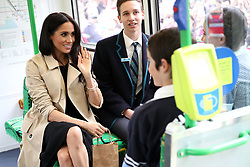 MELBOURNE, AUSTRALIA - OCTOBER 18: Meghan, Duchess of Sussex talks to students from Albert Park Primary School, Port Melbourne Primary School and Elwood Secondary College while riding on a Melbourne Tram on October 18, 2018 in Melbourne, Australia. The Duke and Duchess of Sussex are on their official 16-day Autumn tour visiting cities in Australia, Fiji, Tonga and New Zealand. (Photo by Chris Jackson - Pool/Getty Images)