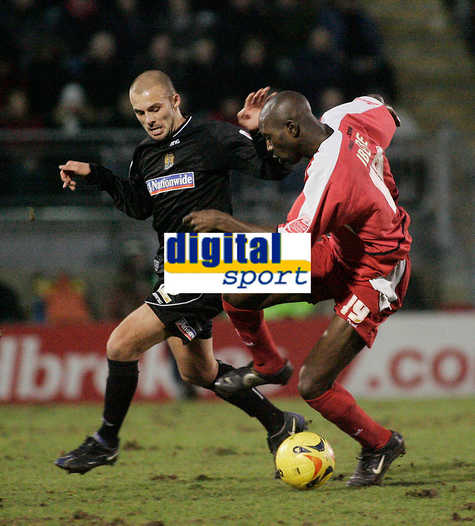 Jabo Ibehre and David Hunt.<br /> Leyton Orient v Northampton Town, Coca Cola League 2, London. 14/01/06 Photo by Barry Bland
