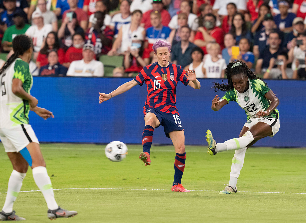 USA's MEGAN RAPINOE (15) tried to block the shot of MICHELLE ALOZIE (22) of Nigeria  as the US Women's National Team (USWNT) beats Nigeria, 2-0 in the inaugural match of Austin's new Q2 Stadium. The U.S. women's team, an Olympic favorite, is wrapping up a series of summer matches to prep for the Tokyo Games.